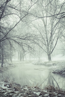 Germany, Bavaria, Landshut, flood channel in winter - SARF001345