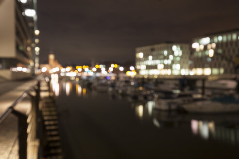 Germany, Cologne, Rheinau harbour at night, blurred - WIF001392