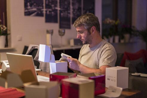 Man installing wireless sockets - SHKF000251