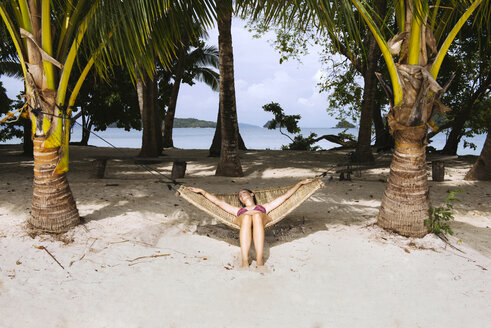 Philippines, Palawan, Woman relaxing on beach hammock - GEMF000047