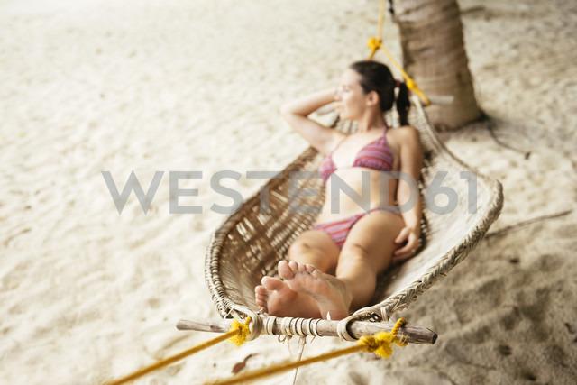 Philippines, Palawan, woman relaxing in a hammock near El Nido - GEMF000052