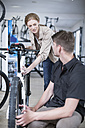 Young salesman and client looking at bicycles - ZEF005032