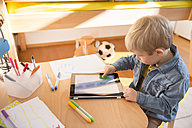 Little boy drawing with digital tablet - MFF001509
