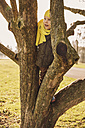Little boy climbing on a tree in winter - MFF001496