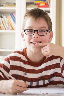 Portrait of smiling boy wearing glasses - LVF002885