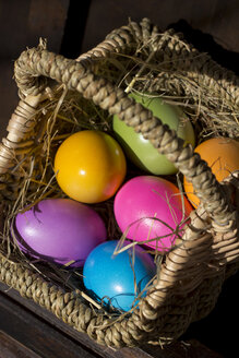 Coloured Easter eggs in a basket - YFF000318