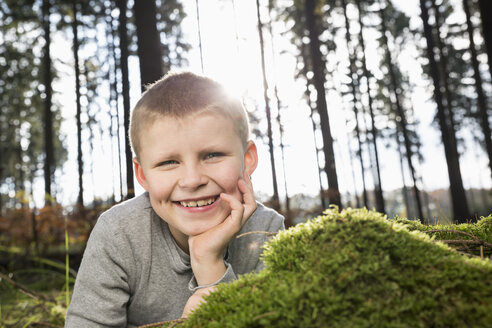 Germany, portrait of smiling little boy in a forest - PDF000814