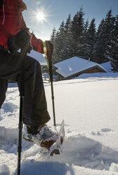Austria, Tyrol, Schwaz, woman snowshoeing - MKFF000173