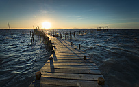 Portugal, Carrasqueira, wooden boardwalk for fishing at sunset - STCF000080
