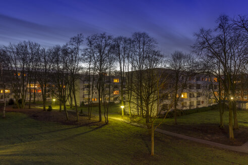 Germany, Bremen, Moving clouds over an apartment block in the evening - NK000232
