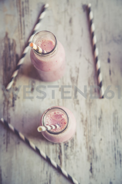 Two glasses of banana strawberry smoothie - SARF001387