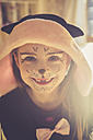 Portrait of smiling little girl with tooth gap masquerade as a cat - SARF001385