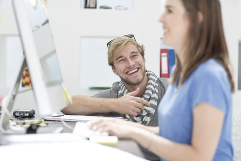 Creative office people discussing work on a computer - ZEF002983