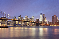 USA, New York, New York City, Manhattan, Brooklyn Bridge and skyline at dusk - FPF000038