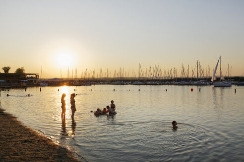Austria, Burgenland, Rust at Lake Neusiedl, swimming area and marina at sunset - SIEF006486