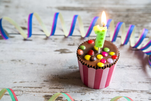 Birthday muffin with chocolate buttons and lighted candle - SARF001407