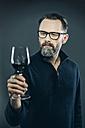 Man tasting red wine - IPF000196