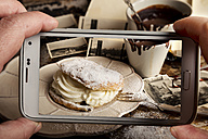 Woman photographing food with smartphone - CSTF000873