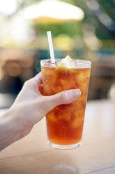 USA, Hawaii, Maui, hand holding iced tea with lemon - BRF000992