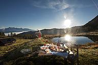 Austria, Salzburg State, Altenmarkt-Zauchensee, alpine pasture, breakfast at sunrise - HHF005112