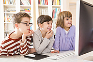 Boy and his two sisters spending time at computer - LVF002932