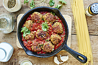 Vegan meatless balls in tomato sauce in a cast iron pan - HAWF000674