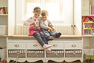 Brother and sister with wooden toys at home - OPF000050
