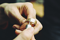 Goldsmith working on wedding rings - KRPF001323
