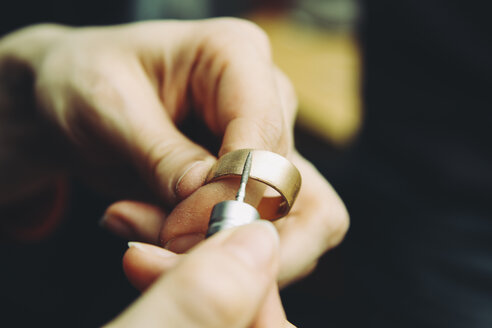 Goldsmith working on wedding rings - KRPF001323