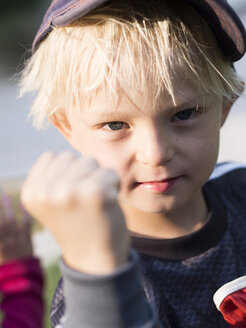 Blond boy making fist, soccer fan - GSF000995