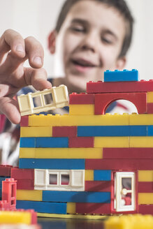 Boy playing with children's building bricks - DEGF000360