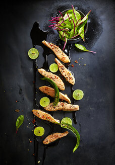 Foodart, fried salmon, lime, black sesame, chard, red chili and green chili pepper - KSWF001418