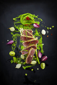 Foodart, slices of raw tuna with herbs and wasabi pea paste - KSWF001424