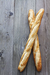 Two French baguettes on grey wood - CSF024704