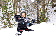 Happy boy playing with snow in the woods - GEMF000079