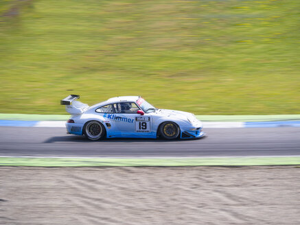 Germany, Hockenheimring, Porsche on race track - AM003845