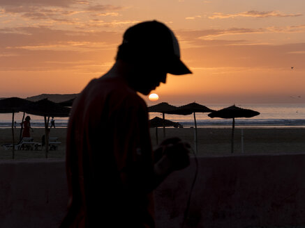 Morocco, Essaouira, people on beach at sunset - STDF000121