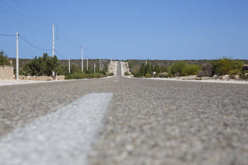 Morocco, country road under blue sky - STDF000117