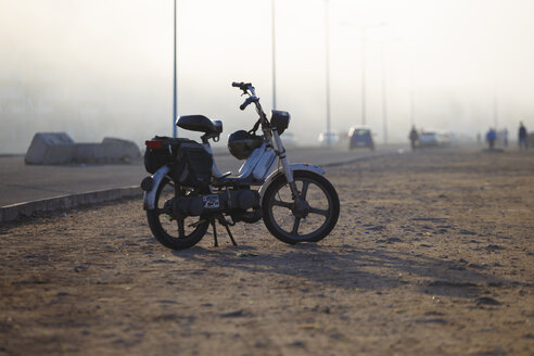 Morocco, Casablanca, motorcycle by the roadside - STD000123