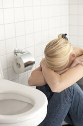 Despaired anorexic young woman at the toilet - DRF001536