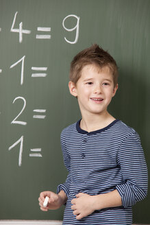 Schoolboy at blackboard with arithmetic problems - MFRF000069
