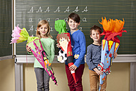 Happy pupils with school cones at blackboard - MFRF000072