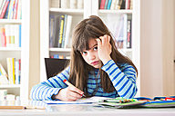 Frustrated girl doing homework - LVF002964