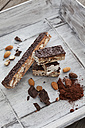 Italian bars of nougat, almond, hazelnut, cocoa powder, chocolate on wooden tray - CSF024747
