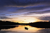 Ecuador, Amazon River region, dugout canoe on Lake Pilchicocha at sunset - FOF007758