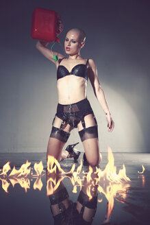 Young woman wearing lingerie with gas can near by flames - VEF000037