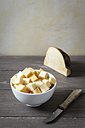 Bowl of diced swede and kitchen knife - EVGF001275