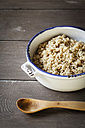 Pot of wholegrain rice and wooden spoon - EVGF001278