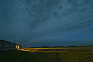 Iceland, view to lighted motel by night - NHF001471