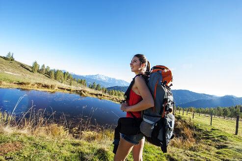Austria, Altenmarkt-Zauchensee, young woman hiking in the Lower Tauern - HHF005184